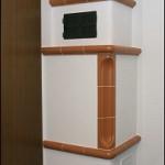 Holzbrand-Kachelofen für zwei Räume mit Beheizung von Diele